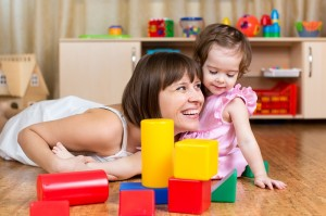 Mother and Daughter with Blocks